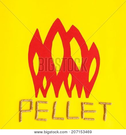 grains of pressed wood are laid at the base of red flames to create united togheter form the word pellet