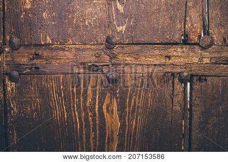 Old wood texture and background. Old wooden door background. Close up view of rough wood texture and background. Abstract texture and background for designers. Vintage wood table.