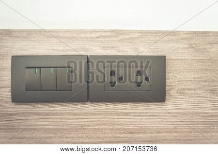 outlet switch on wall in home Equipment that connects electrical signals to various home appliances.