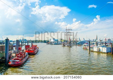 Hamburg Germany - 17 September 2017: Sailing yachts powerboats ships and other water transport in the port of Hamburg.