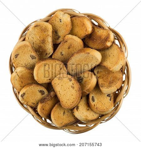Small Rusks With Raisin In Wicker Basket Isolated On White