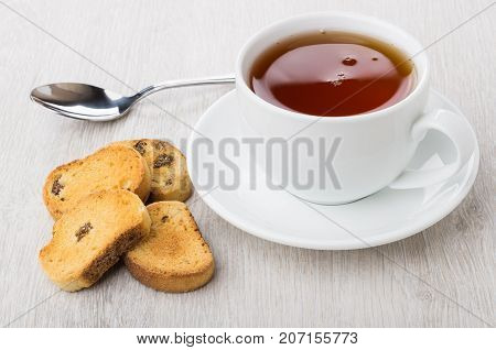 Rusks With Raisin, Tea In Cup With Saucer And Teaspoon