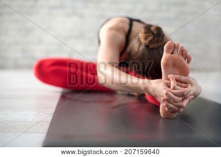 adult woman practicing yoga in a yoga studio