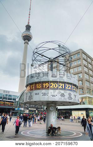 BERLIN - AUGUST 21 2017: Alexanderplatz on a sunny day on August 21 2017 in Berlin Germany. It's a large public square and transport hub in the central Mitte district of Berlin near the Fernsehturm.