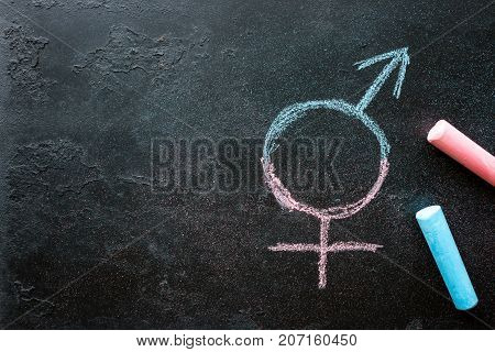 Symbol Of A Transgender Drawn Chalk On A Black Background With Space For Text