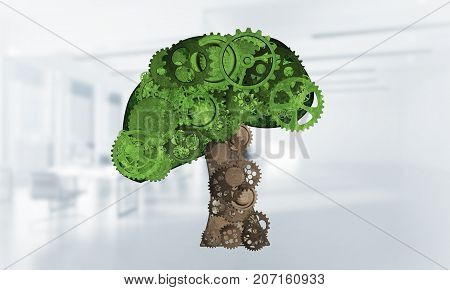 Green tree made of gears and cogwheels on white office background. 3d rendering