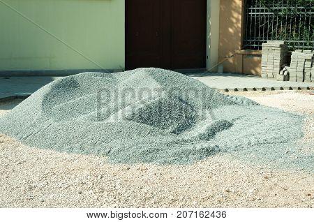Gravel stone pile on the street pavement reconstruction site