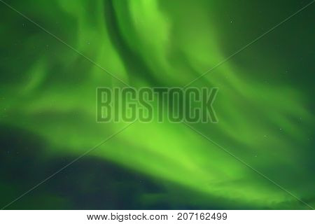 Northern lights patterns in night sky close-up. Beautiful aurora borealis in northern sky.