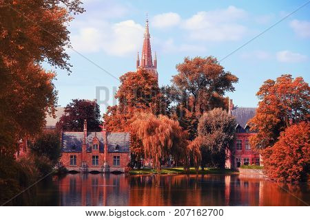 Autumn day in Brugge. Trees with red foliage in famous destination of Belgium in Brugge.