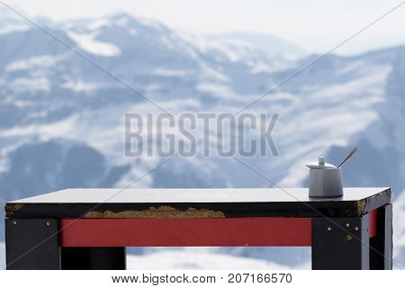 Old Table With Sugar Bowl In Outdoor Cafe At Ski Resort