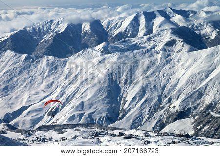 Paragliding At Snow Mountains Over Ski Resort