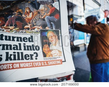 PARIS FRANCE - OCT 3 2017: Photo of killer Stephen Paddock in newspaper with socking title and photo at press kiosk about the 2017 Las Vegas Strip shooting in United States with about 60 fatalities and 527 injuries