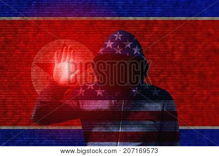 An american flag hooded hacker touching the flag of north korea with computercode texture cyberattack concept
