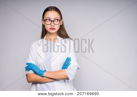 girl nurse with glasses folded her arms looking away