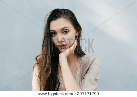 the girl with a serious expression put her head in her hand