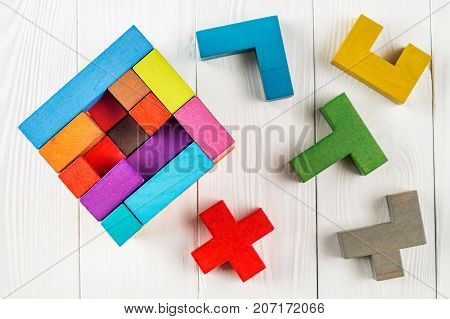 Concept of decision making process creative logical thinking. Geometric shapes in different colors top view. Choose correct answer. Logical tasks. Conundrum find the missing piece of the proposed.