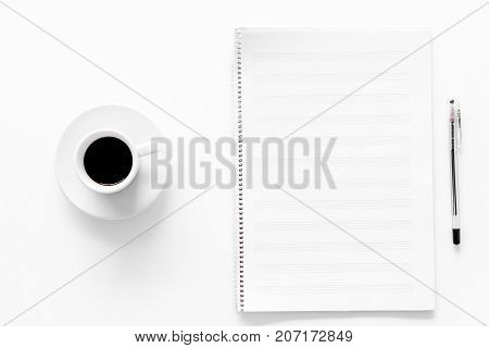 Compose music. Music notes and cup of coffee on white background top view.
