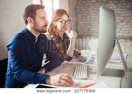 Programmers working in a software developing company office