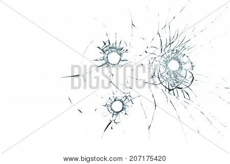three bullet holes in glass closeup on white background