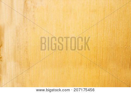 Texture of light yellow wood refined, like the ecological cardboard