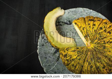 yellow fresh sweet Melon on black background