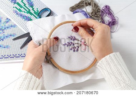 Women's Hands With A Cross Embroidered On The Fabric Patterns Of Flowers