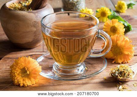 Calendula Tea With Calendula Flowers On A Wooden Table
