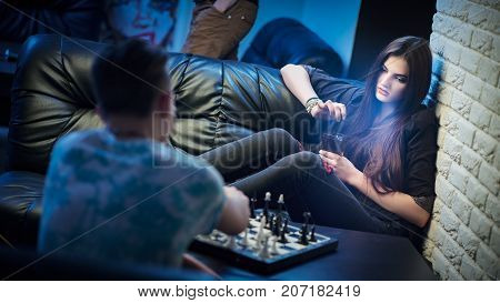 Beautiful Young Woman Play Game Of Chess