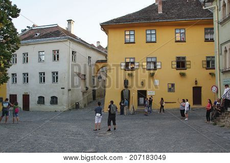 Sighisoara Transylvania Romania - September 11 2017: medieval old town surrounded by defensive walls. In the yellow tenement house was born in 1431 Vlad Tepes a cruel ruler. He became the inspiration for the legend of Count Dracula.