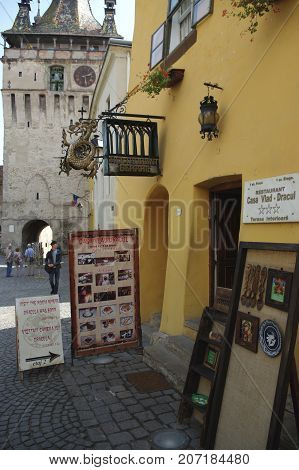 Sighisoara Transylvania Romania - September 12 2017: medieval old town surrounded by defensive walls. In the yellow tenement house was born in 1431 Vlad Tepes a cruel ruler. He became the inspiration for the legend of Count Dracula.