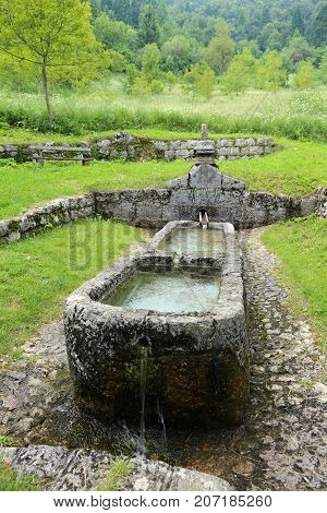 big ancient fountain at mountain called Fontana della Pace that means Fountain of Peace in Italian Language