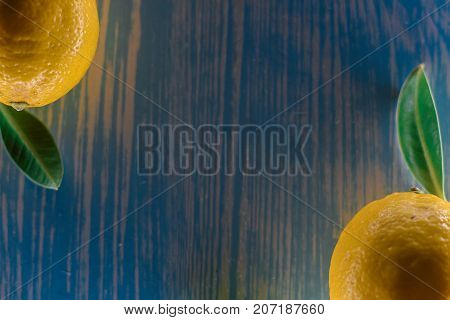 lemon lying on a wooden table with leaves