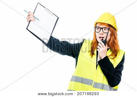 Emotional Foreman With A Walkie-talkie In A Vest And A Yellow Hard Hat On A White Background