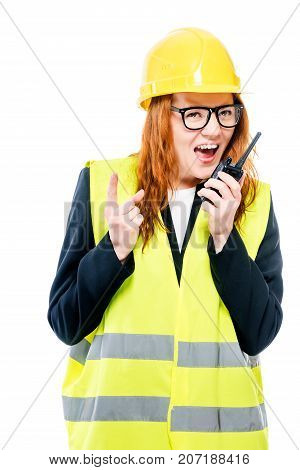 Young Girl Foreman Screaming In Walkie-talkie On White Background