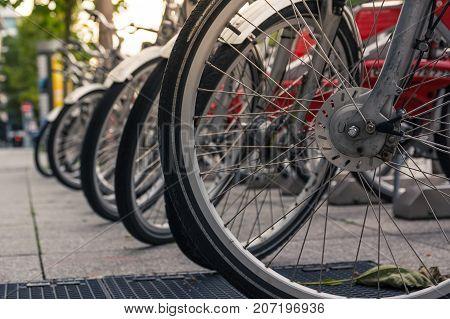 Bike Wheels in Rack Closeup Detail Shot City Urban Environment Public Sharing Bicycle