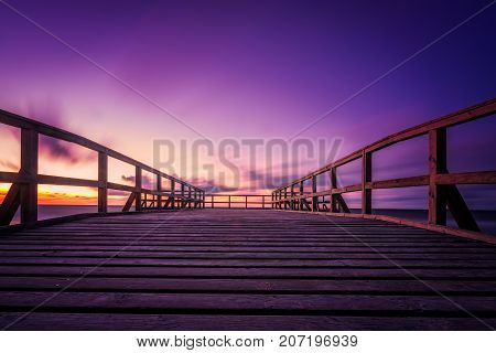 Wooden pier on the sea beach at sunset, Sarbinowo, Baltic Sea, Poland