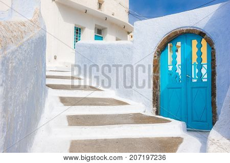 Narrow neighborhood at the old traditional village of Pyrgos, Santorini, Greece.