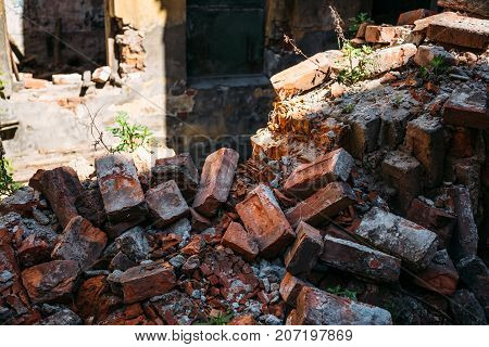 Close-up of a pile of bricks of a destroyed house with an earthquake, selective focus