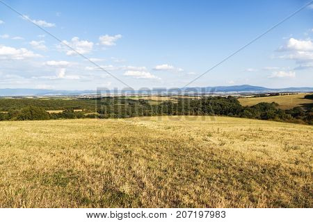 Meadow landscape in the middle of slovakia with blue sky and clouds in autumn (fall). Countryside forest with panoramic view on the hills. Autumn landscape. Beautiful hilly landscape