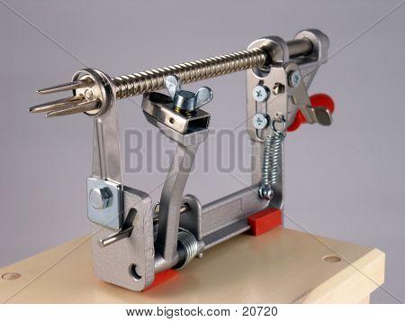 a stainless steel apple peeler/corer. poster