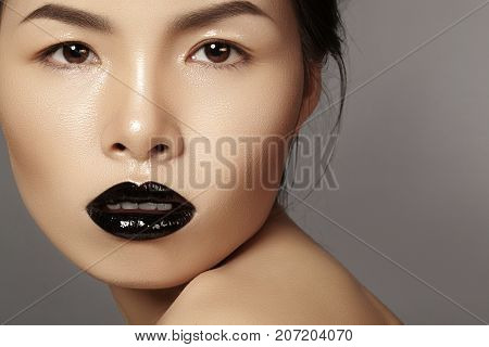 Close-up Portrait Asian Model With Fashion Lips Make-up, Clean Skin. Beauty Halloween Style With Bla
