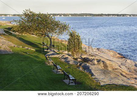 Early autumn evening overlooking rocky shoreline at Fort Phoenix in Fairhaven Massachusetts