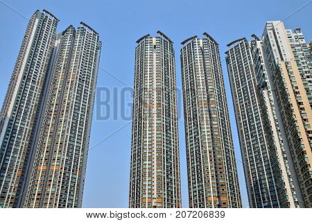 High density residential building in Hong Kong with blue sky background