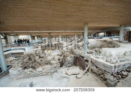 Santorini, Greece - April 20, 2017: Akrotiri is an archeological site from the Minoan Bronze Age on the Greek island of Santorini (Thera). Photo of recovered ancient buildings and decorated pottery.