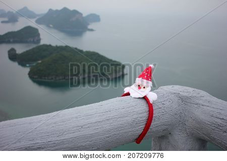 anta Claus hair band on the mountain with island views of Ang thong archipelago.Thailand.