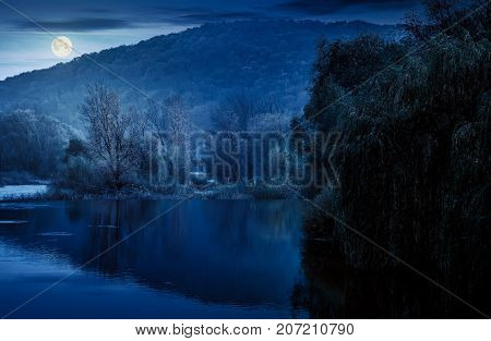 Landscape With Calm River In Autumn At Night