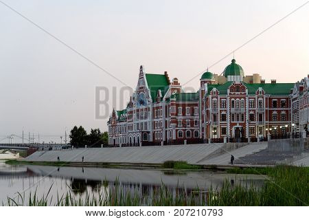 Yoshkar-Ola, Russia - August 30, 2017 Photo of the view on the embankment of Amsterdam in Yoshkar-Ola and the building in the European style