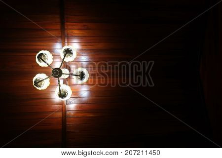 The light of a lamp with wooden ceilings in the wooden house.