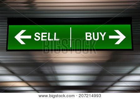 Financial concept. Sell and Buy Arrows sign indicated stock market activity.