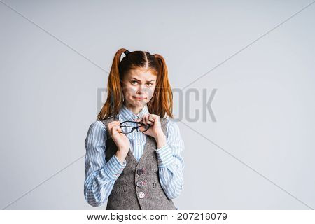 a frustrated girl with tails and glasses looks at the camera